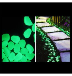 Sassi in plastica fluorescenti fosforescenti che si illuminano al buio