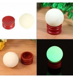 4 sfere fosforescenti in calcite fotoluminescenti si illuminano al buio